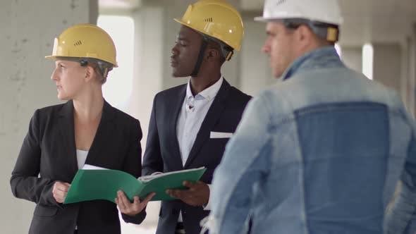 Thumbnail for Business People Group on Meeting and Presentation in Construction Site