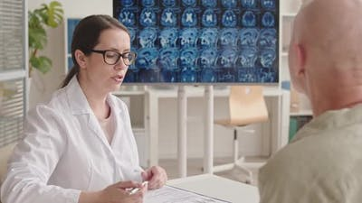 Oncologist Speaking to Female Patient with Brain Cancer