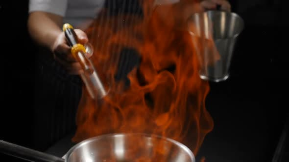 Thumbnail for Slow Motion View of Big Fire Flame Over Frying Pan. Close Up. Hands with Gas Burner and Stainless