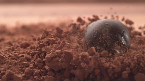 Thumbnail for Chocolate truffles falling into chocolate powder in super slow motion.  Shot on Phantom Flex 4K high