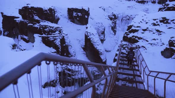 Thumbnail for Iceland Winter View Of Tourist Walking Out To View Large Snow Covered Valley In Winter At Sun Down 1