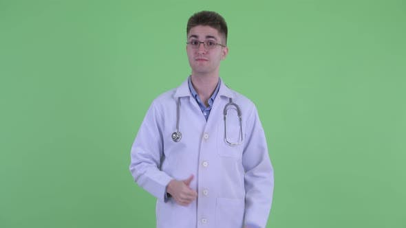 Thumbnail for Happy Young Man Doctor Giving Thumbs Up
