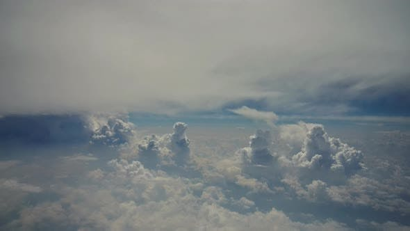 Amazing Skyline View From Airplane Sky Above the Clouds