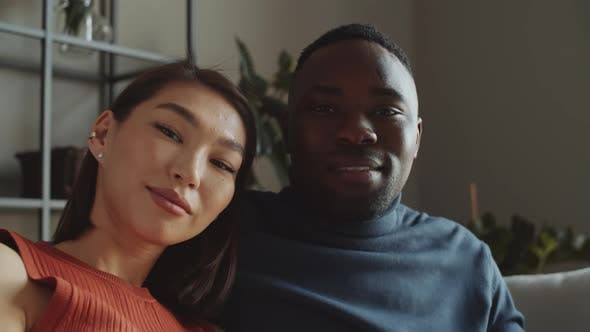 Thumbnail for Portrait of Cheerful Multiethnic Couple on Sofa