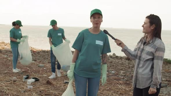 Thumbnail for Reporter Interviewing One of Volunteers