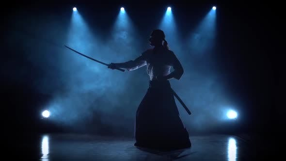 Master Martial Arts Aikido Training With Japanese Sword Katana On Spotlights Background By Kinomaster On Envato Elements