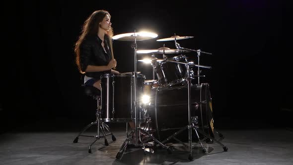 Thumbnail for Drummer Girl Starts Playing Energetic Music, She Smiles. Black Background