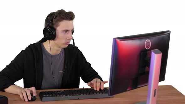Gamer Guy in Headphones Playing Video Games on Computer and Winning on White Background.