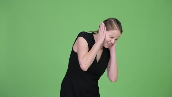 Thumbnail for Young Stressed Businesswoman Covering Ears From Loud Noise