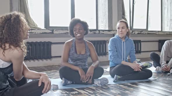 Cover Image for Young Women Chatting in Yoga Class