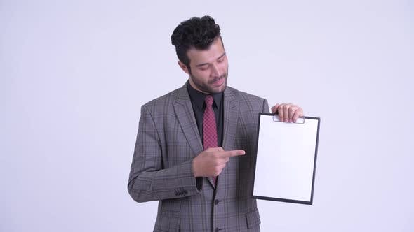 Thumbnail for Happy Bearded Persian Businessman Showing Clipboard and Giving Thumbs Up