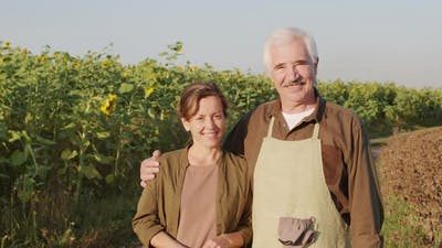 Portrait Of Cheerful Farmers In Countryside