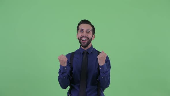 Thumbnail for Happy Young Bearded Persian Businessman Getting Good News