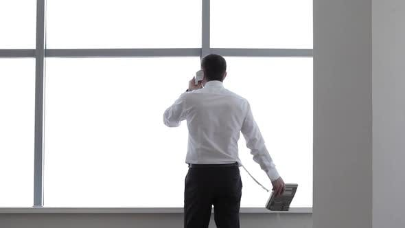 Thumbnail for Businessman Talking on the Phone in his Office