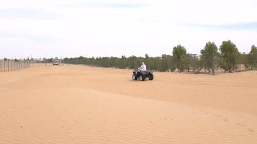 Bedouin Rides on an ATV in the Desert