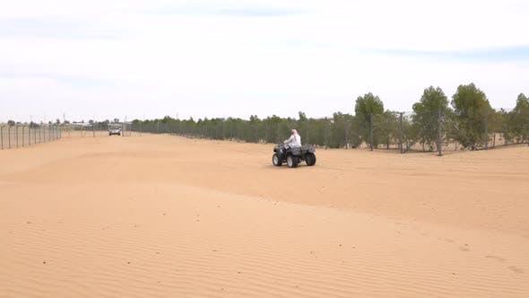 Thumbnail for Bedouin Rides on an ATV in the Desert