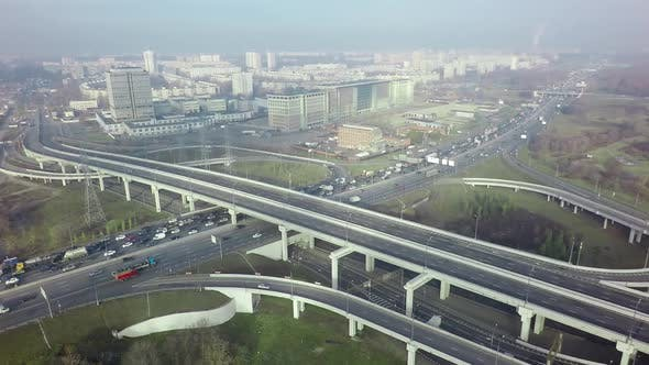 Thumbnail for An Aerial View of a Road Interchange Against the Misty Urban View