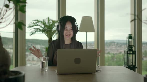Thumbnail for Young Asian Female Listening Music on Laptop Computer at Home