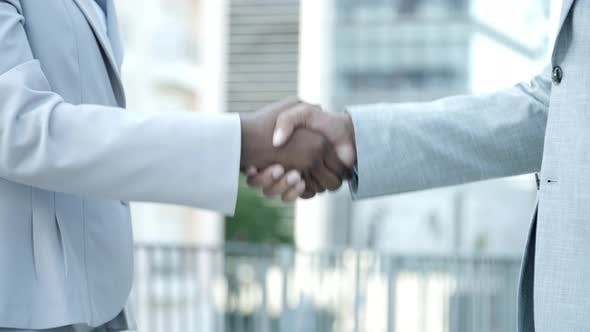 Thumbnail for Slow Motion Shot of Business Partners Shaking Hands Outdoor