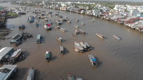 Aerial: flying over Cai Rang floating market on the river, Can Tho, Vietnam