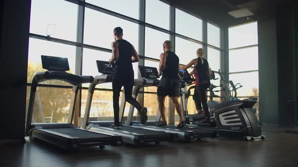 Thumbnail for A Group of People Running on a Treadmill in a Fitness Room Performing a Cardio Workout