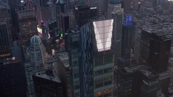 Thumbnail for AERIAL: Epic View of Huge Enormous New Manhattan Skyscraper at Sunset with Traffic Lights and New