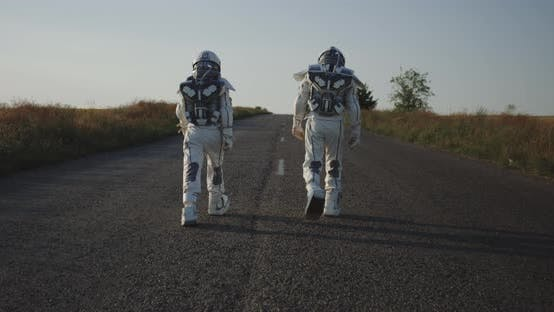 Thumbnail for Two Astronauts Walking on Road