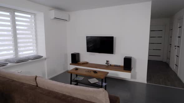 Thumbnail for Living Room with Tv and Couch in Modern Cozy Apartment, Minimalistic Design