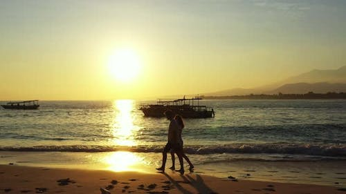 Young Lady and Man on Honeymoon Vacation Enjoy Life on Beach on Paradise White Sand