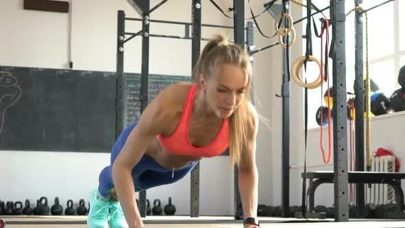 Thumbnail for Athletic Woman Does Push-ups in the Gym