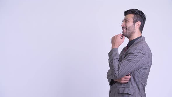 Thumbnail for Profile View of Happy Bearded Persian Businessman Thinking