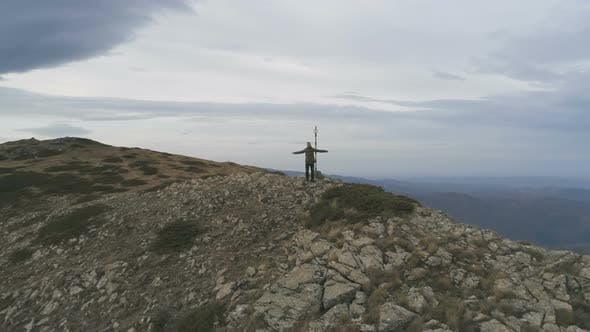 Thumbnail for Male Hiker Standing on Peak and Victoriously Raising Arms Rejoicing Success