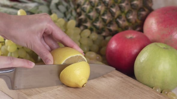Thumbnail for Lemon Is Cut Into Slices