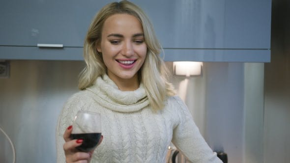 Thumbnail for Cheerful Woman Drinking Wine in Kitchen