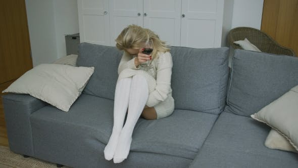 Thumbnail for Drunk Woman with Wine Sitting on Sofa