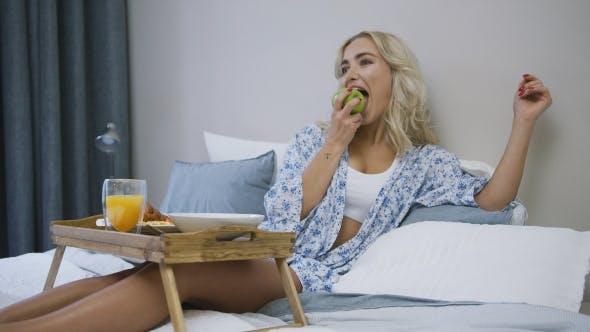 Thumbnail for Woman Eating Apple for Breakfast
