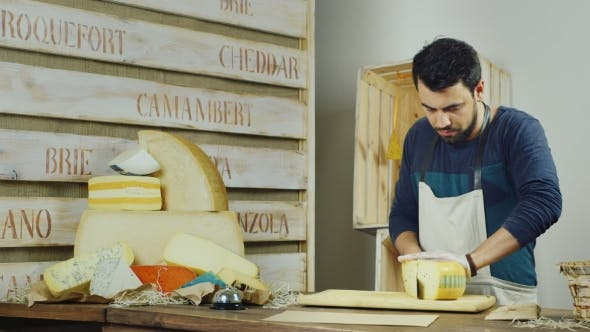Thumbnail for Attractive Man Working in the Store Cheese.