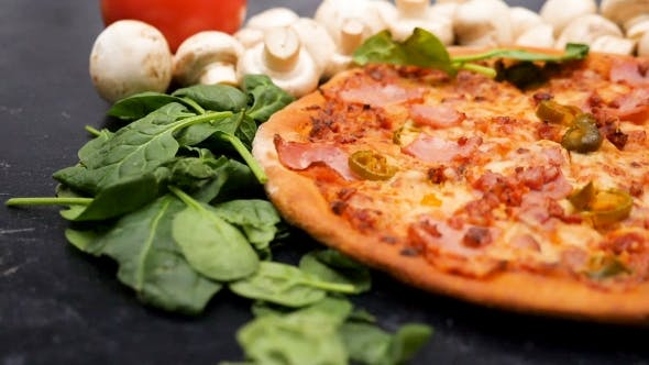 Thumbnail for of Leaves of Baby Spinach Falling on Fresh Baked Pizza