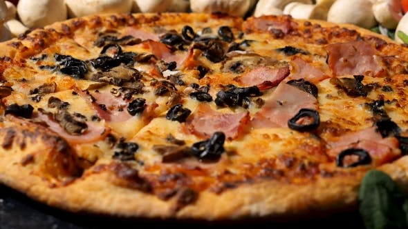 Thumbnail for Cutted Mushrooms Falling on Delicious Pizza