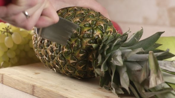 Thumbnail for The Cook Cuts a Big Pineapple