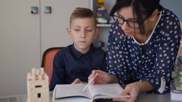 Thumbnail for Teacher Explains to His Schoolboy the Homework that Was Done at the School
