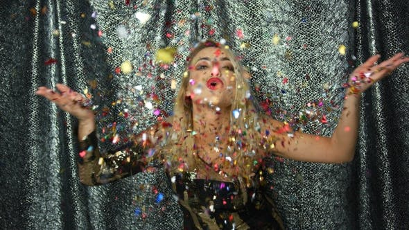 Thumbnail for Woman Throwing Up and Blowing at Confetti