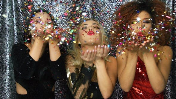 Thumbnail for Pretty Women Blowing on Confetti