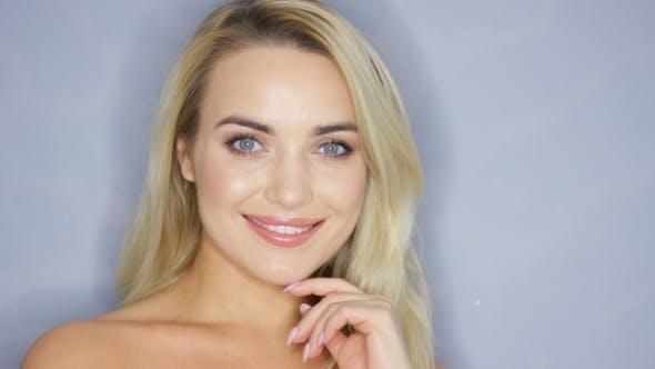 Thumbnail for Smiling Blonde Model in Studio