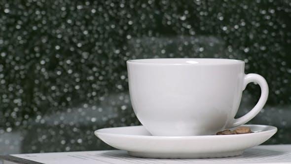 Thumbnail for Coffee Cup Against Rain