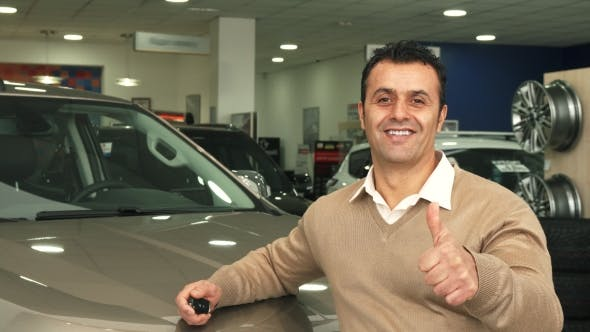 Thumbnail for A Good Man Examines the Car Salon and Shows a Thumbs Up