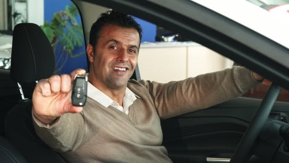 Thumbnail for The Satisfied Man Shows the Keys To a New Car