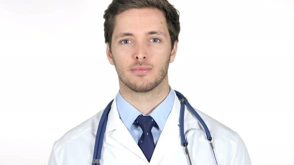 Thumbnail for Doctor Looking at Camera, White Background