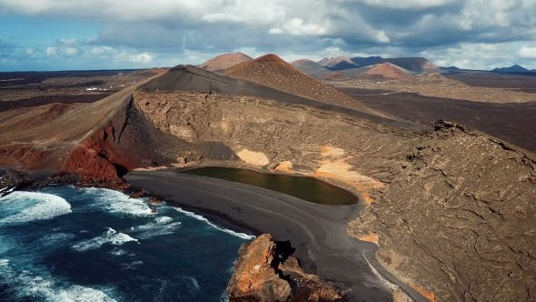 Flying over Volcanic Lake El Golfo near Lanzarote in Canary Islands.
