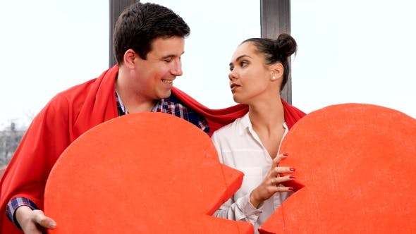 Thumbnail for of Couple with a Big Novelty Red Heart